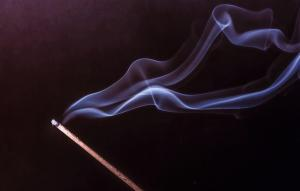 An incense stick with a beautiful smoke trail